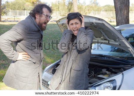 Unhappy man shouting to girlfriend after car accident - stock photo