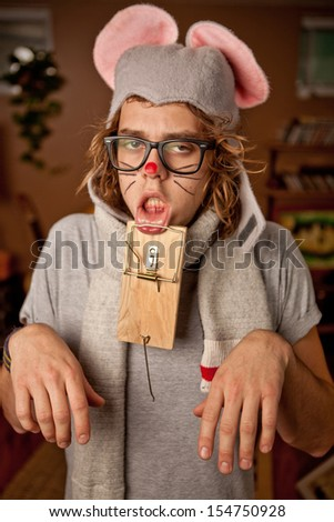 Unhappy Man wearing a mouse costume got trapped - stock photo