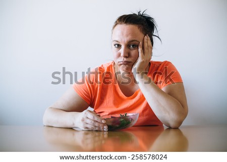 Unhappy overweight woman on diet