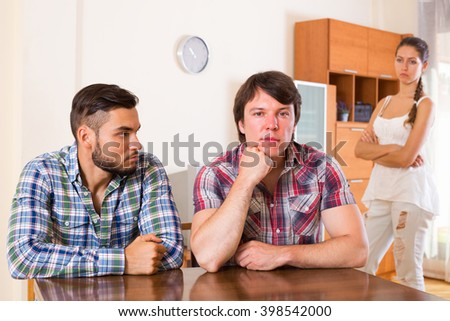 unhappy partners having domestic quarrel at home interior