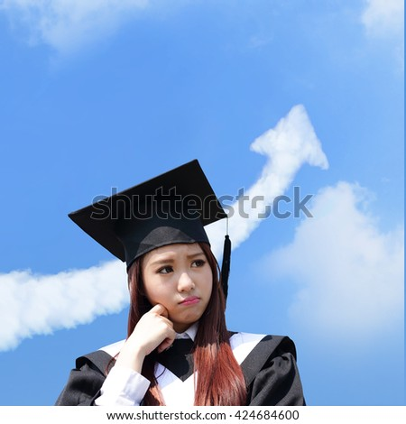 unhappy sad student woman graduating with cloud arrow in the sky, asian beauty - stock photo