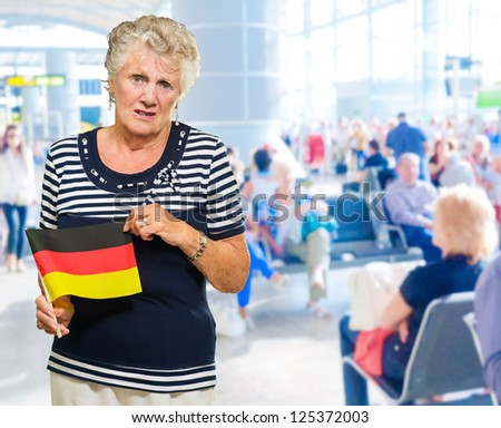 Unhappy Senior Woman Holding Germany Flag, Indoors