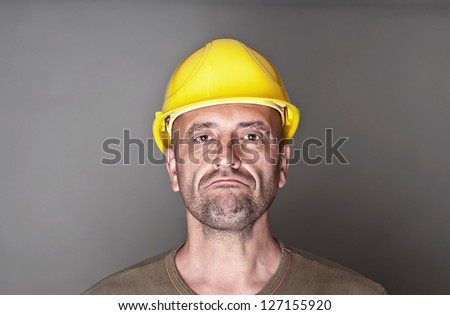 Unhappy, skeptical worker - stock photo