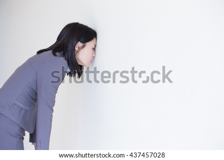 Unhappy thinking business woman with white wall background, great for your design or text, asian - stock photo
