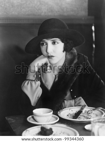 Unhappy woman after meal - stock photo