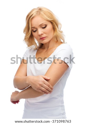 unhappy woman suffering from pain in hand