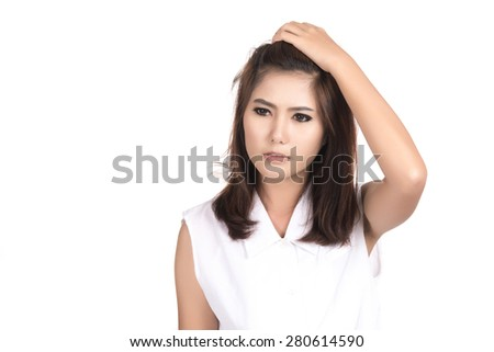 Unhappy young Asian woman with blank copyspace area for text or slogan,Closeup portrait of beautiful Asian woman,Thai girl,Negative human emotion facial expression,isolated on white background - stock photo