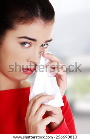 Unhappy young beautiful woman crying - stock photo