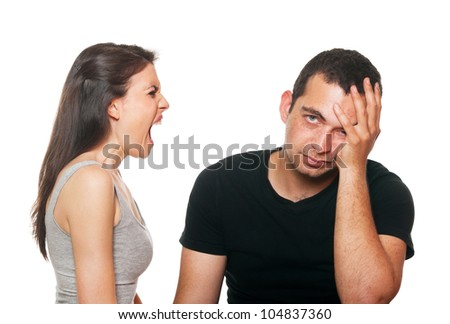 Unhappy young couple having an argument. Isolated on white. - stock photo