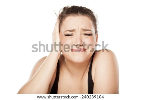 unhappy young woman has pain in the ear - stock photo