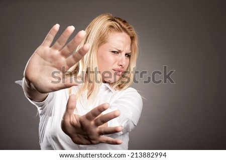 unhappy young woman with disapproval expression - stock photo