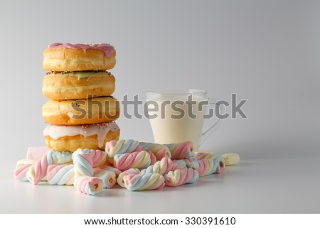 unhealthy breakfast concept. Donuts with twisted marshmallow and milk