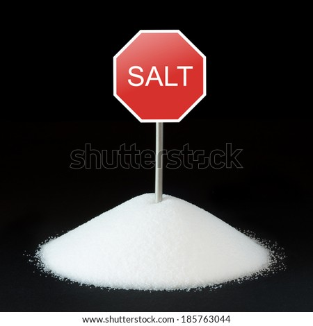Unhealthy food concept - salt and road sign - stock photo