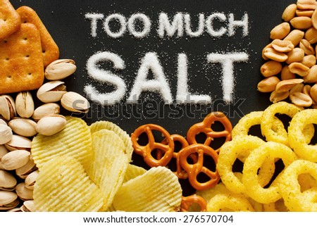 Unhealthy food concept - salt in food - stock photo