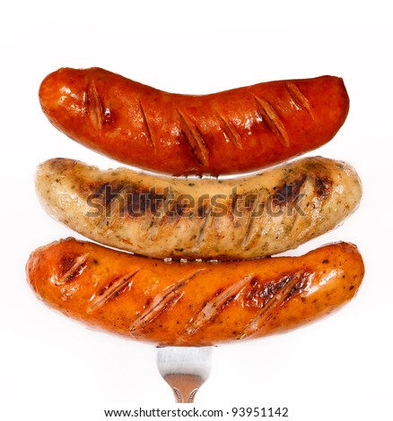 Unhealthy grilled barbecue sausage isolated on white background