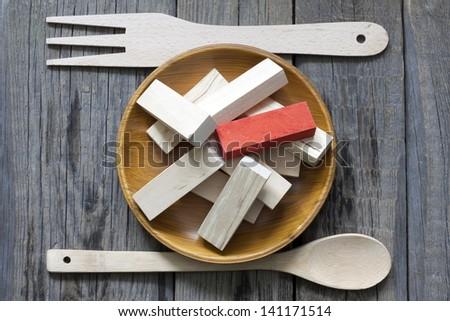 Unhealthy junk food creative concept comparison to wooden blocks - stock photo