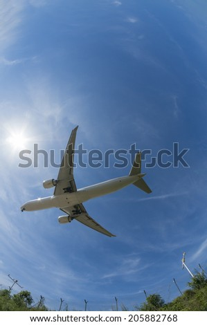 Unidentified aircraft flies above taken with fisheye lens. - stock photo