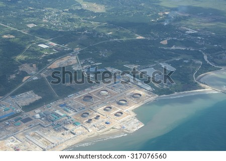 Unidentified an oil depot or terminal and power plant from aerial view.