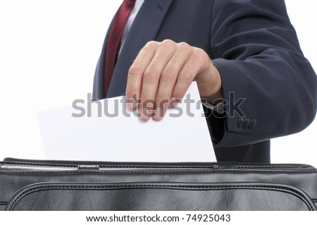 Unidentified business man pulls a blank document from his briefcase.  Add your text.