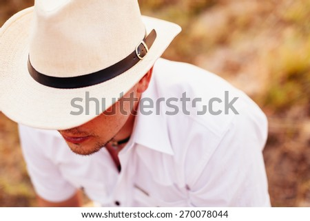unidentified cowboy man dream in hat top view - stock photo
