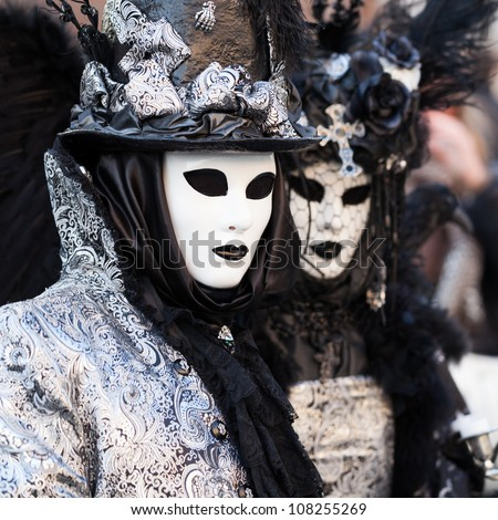 Unidentified persons in Venice mask at St. Mark's Square, Carnival of Venice on February 12, 2012.