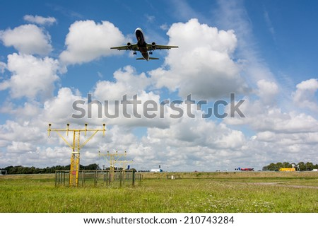 unidentified plane on landing approach at amsterdam airport