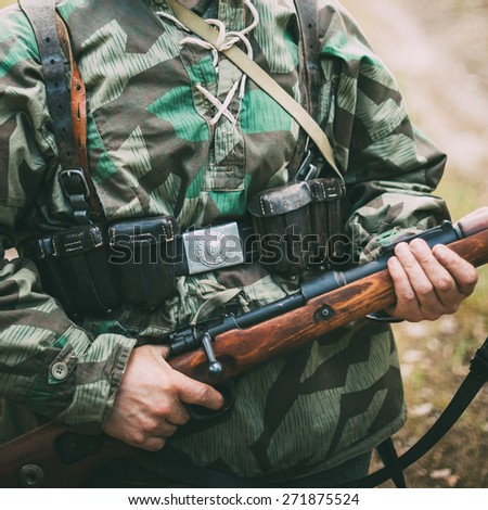 Unidentified re-enactor dressed as German soldier. German military decoration on the uniform of a German soldier