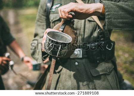 Unidentified re-enactor dressed as German soldier. German military decoration on the uniform of a German soldier. - stock photo