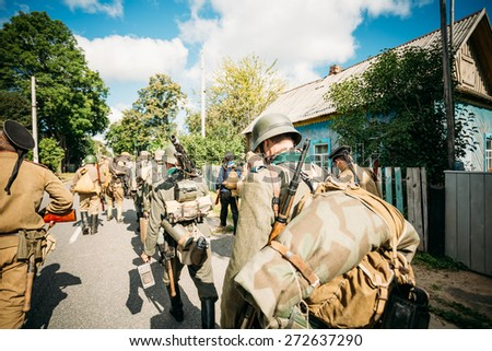 Unidentified re-enactors dressed as German and Soviet Russian soldiers  during march - stock photo