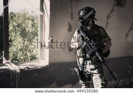 Unidentified soldier with mask aiming a rifle / Special forces soldier with rifle / Military, war, conflict, soldiers - Special forces soldier man hold Machine gun