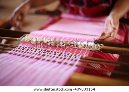 Unidentified women weaving traditional thai fabric, Chiang Mai, Thailand - stock photo