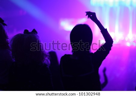Unidentified young Japanese people partying at an unknown concert in Tokyo, Japan - stock photo