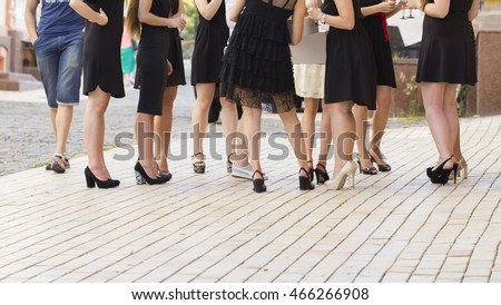 Unidentified young pretty women on high heels celebrating some event