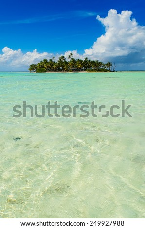Uninhabited or desert island in the Blue Lagoon inside Rangiroa atoll, an island of the Tahiti archipelago French Polynesia in the Pacific Ocean.  - stock photo