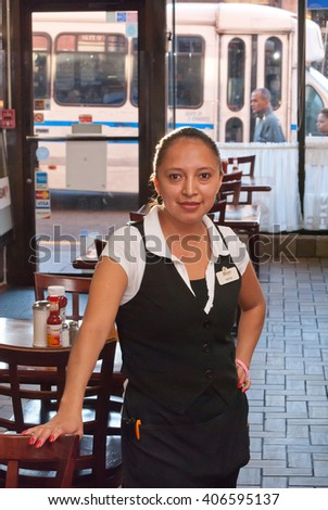 Union City, NJ, September, 2015, A female waitress standing in a restaurant ready to serve a meal at El Artesano Restaurant, Union City, NJ