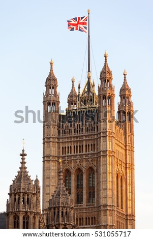 Union Flag flying on top of the Victoria Tower, part of the Palace of Westminster the seat of Government in London, UK.