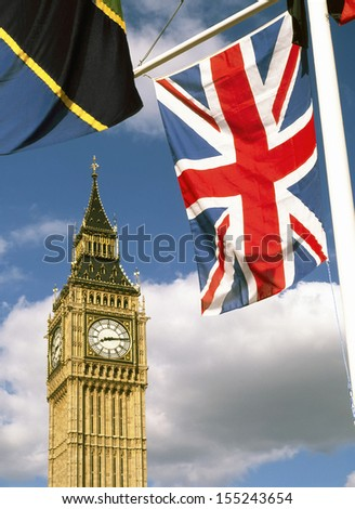 Union flag in Parliament Square Westminster London with Elizabeth Tower (Big Ben) beyond - stock photo