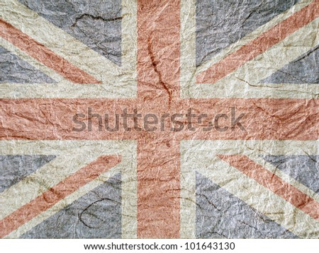 Union Jack flag overlaid onto rough textured paper - stock photo