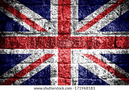 Union jack flag painted on old brick wall texture background