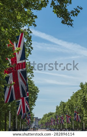 Union Jack flags line The Mall to Buckingham Palace in London on a sunny day - stock photo