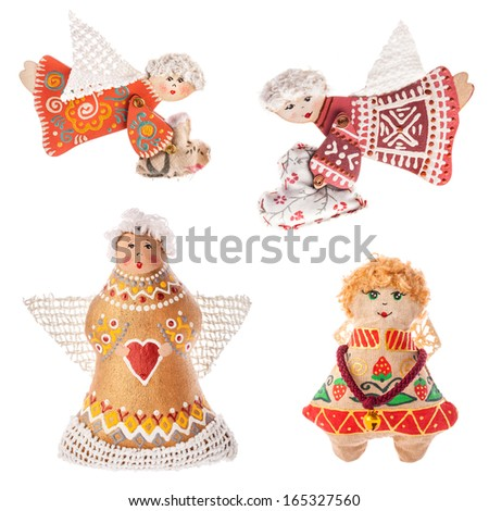 Unique Christmas Ukrainian souvenir - Angels. The toy is made from natural fabrics. Isolated on white