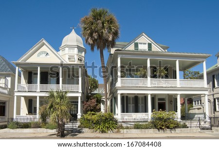 Unique colonial era houses on Battery Street, built in the eighteenth century, in Charleston, South Carolina. - stock photo