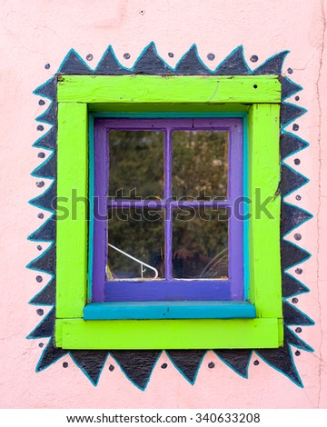 Unique green and purple gallery window in Madrid, NM - stock photo
