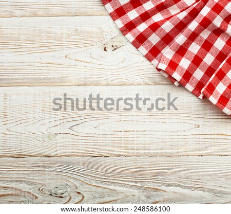 Unique perspectives top view. Wooden table covered with tablecloth. View from top. Empty tablecloth for product montage. Free space for products and for your text. - stock photo