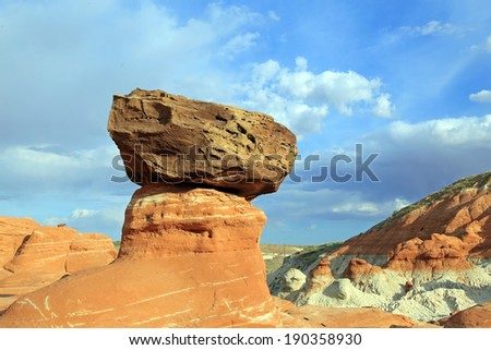 Unique sandstone rock balanced on a hoodoo, Utah, USA. - stock photo