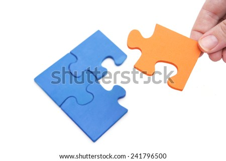 Unique Solution  - final piece of the the puzzle - stock photo