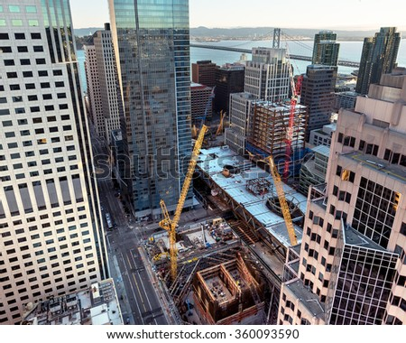 Unique view looking down on construction of multiple buildings in San Francisco's Transbay Transit Center District - stock photo