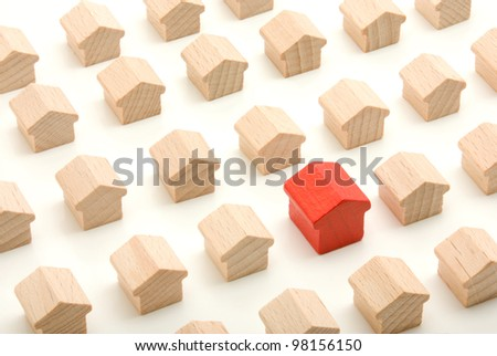 Unique wooden house in group, standing out from the crowd - stock photo