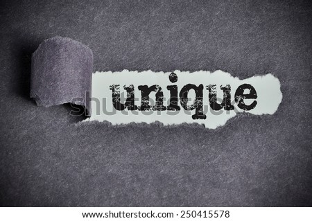 unique word under torn black sugar paper  - stock photo