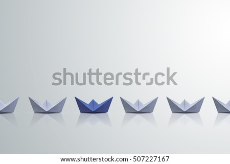 uniqueness concept, paper boat outstanding from the others